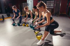 Functional fitness workout in gym with kettlebell Stock Image