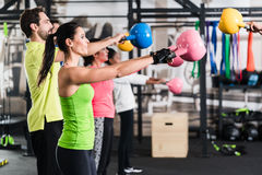 Functional fitness workout in sport gym. With kettlebell Stock Photo