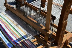 Functional historical wooden hand-loom weaving colorful mat with vertical lines displayed on festival of medieval and traditional Royalty Free Stock Photography