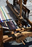 Functional historical wooden hand-loom weaving colorful mat with vertical lines displayed on festival of medieval and traditional Stock Images