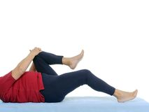 Functional test of hip joint contraction. Older patient performing funtional test of hip joint contraction lying on bed Royalty Free Stock Images