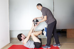Functional training. Physical therapist with patient in a gym Royalty Free Stock Photos