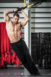 Functional training. Young man streching muscles making functional training Royalty Free Stock Photos