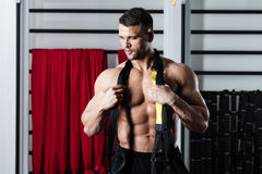 Functional training. Young man streching muscles making functional training Stock Photography