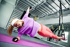 Functional training. Young woman streching muscles making functional training Stock Photography