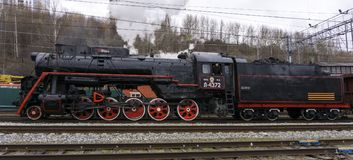 Functioning Soviet class L steam locomotive. Perm, Russia - May 09, 2018: functioning Soviet class L steam locomotive, on the shunting tracks of railway station stock photos