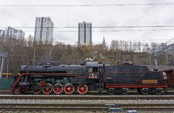 Functioning Soviet class L steam locomotive. Perm, Russia - May 09, 2018: functioning Soviet class L steam locomotive, on the shunting tracks of railway station stock photo