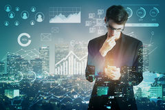 Fund management concept. Handsome young businessman using smartphone on night city and forex chart background. Double exposure. Fund management concept Stock Photography