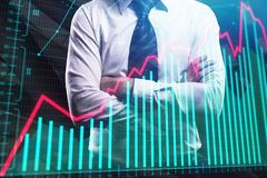 Fund management and finance. Businessman with folded arms standing on abstract forex chart city background. Fund management and finance concept. Double exposure Royalty Free Stock Image