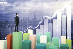 Fund manager on chart bars Royalty Free Stock Photography