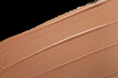 Fundação líquida borrada isolada no preto Fotos de Stock