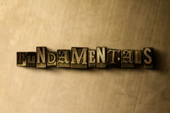 FUNDAMENTALS - close-up of grungy vintage typeset word on metal backdrop Royalty Free Stock Photos
