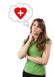 Funderare för ung kvinna om hälsa Royaltyfri Bild