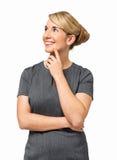 Fundersam affärskvinna With Hand On Chin Smiling Fotografering för Bildbyråer