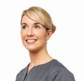 Fundersam affärskvinna Smiling Fotografering för Bildbyråer