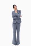 Fundersam affärskvinna som ser till sidan Royaltyfria Foton