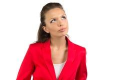 Fundersam affärskvinna som ser upp Royaltyfri Bild