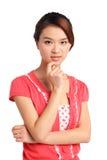 Fundersam asiatisk kvinna Arkivbilder