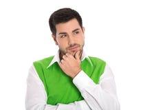Fundersam attraktiv affärsman som isoleras på vit bakgrund. royaltyfri foto