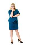 Fundersam blond ledare i blåttklänning royaltyfri foto