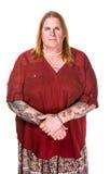 Fundersam eller barsk Transgenderkvinna i pärlemorfärg halsband royaltyfria foton