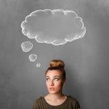 Fundersam kvinna med molnet ovanför hennes huvud royaltyfri fotografi