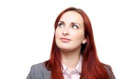 Fundersam kvinna som ser upp Fotografering för Bildbyråer