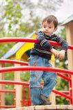 fundersam pojkelekplats Fotografering för Bildbyråer