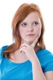 Fundersam redheaded flicka Royaltyfri Fotografi