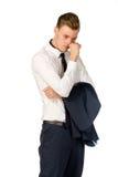 Fundersam ung affärsman som isoleras på vit Arkivbild