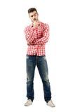 Fundersam ung man som har ett dilemma Royaltyfri Bild