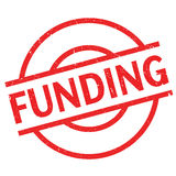 Funding rubber stamp Stock Photo