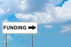 Funding white road sign Stock Photo