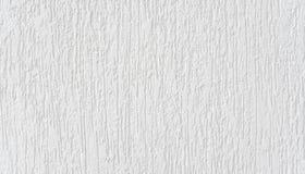 Fundo abstrato branco O fragmento detalhado alto do branco pintou a parede de pedra imagem de stock