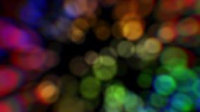 Fundo abstrato colorido Luzes borradas coloridas Partículas do bokeh da cor vídeos de arquivo
