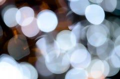Fundo abstrato com luzes e sombra defocused do bokeh Fotografia de Stock Royalty Free