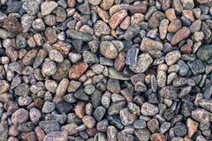 Fundo abstrato com teste padrão decorativo do assoalho de pedras do cascalho do mar, fotografia de stock