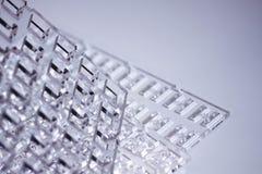 Fundo abstrato da alto-tecnologia Uma folha do plástico ou do vidro transparente com os furos cortados Corte do laser de Imagem de Stock Royalty Free