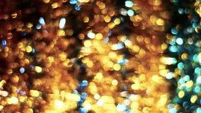 Fundo abstrato de Bokeh do Natal Fim Unfocused do ouropel acima do tiro video estoque