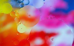 Fundo abstrato de círculos múltiplos em cores vibrantes fotografia de stock