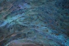 Fundo abstrato de uma parede de pedra em uma luz esmeralda Fotos de Stock Royalty Free
