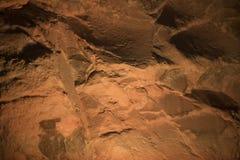 Fundo abstrato de uma parede de pedra em uma luz titsian Imagem de Stock