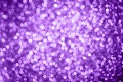 Fundo abstrato do bokeh da luz de Natal dos feriados, cor roxa Imagens de Stock Royalty Free