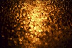 fundo abstrato do ouro com bokeh Fotografia de Stock Royalty Free