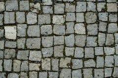 Fundo abstrato do pavimento velho da pedra do granito pavimentar imagem de stock