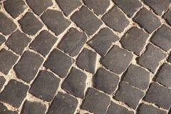 Fundo abstrato natural A textura da estrada de pedra cinzenta velha fotografia de stock