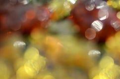 Fundo alegre, abstrato com círculos coloridos do bokeh imagem de stock