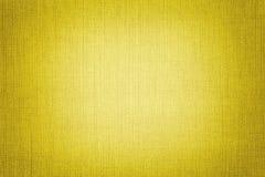 Fundo amarelo brilhante de um material de matéria têxtil r backdrop foto de stock royalty free