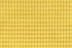 Fundo amarelo brilhante do fim felpudo macio da tela acima Textura das matérias têxteis macro imagens de stock royalty free