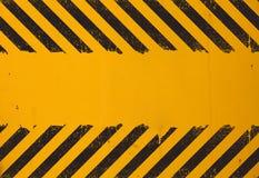 Fundo amarelo com sinal de perigo preto do grunge Imagem de Stock Royalty Free